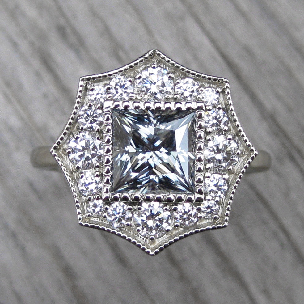 <center><strong>・OCTAVIA・</strong><br></center>Princess Cut Charles & Colvard Grey Moissanite Center, Diamond Halo (1.70ctw)