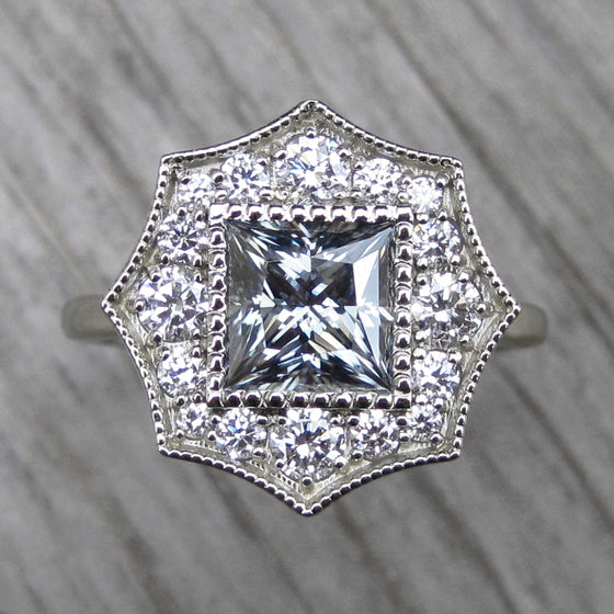 <center><strong>・OCTAVIA・</strong><br></center>Charles & Colvard Grey Moissanite, Diamond Halo (1.70ct)