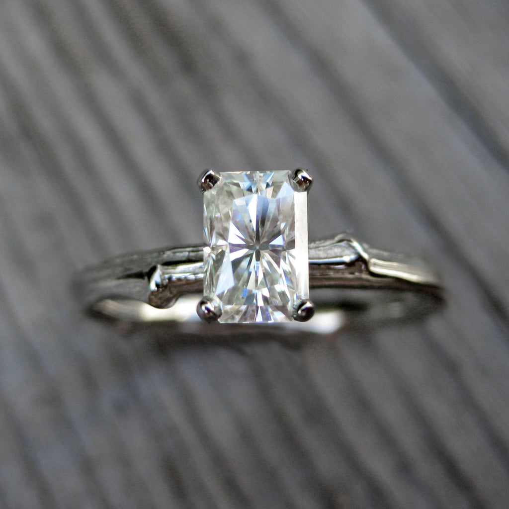 White gold twig solitaire engagement ring with a Forever One radiant cut moissanite