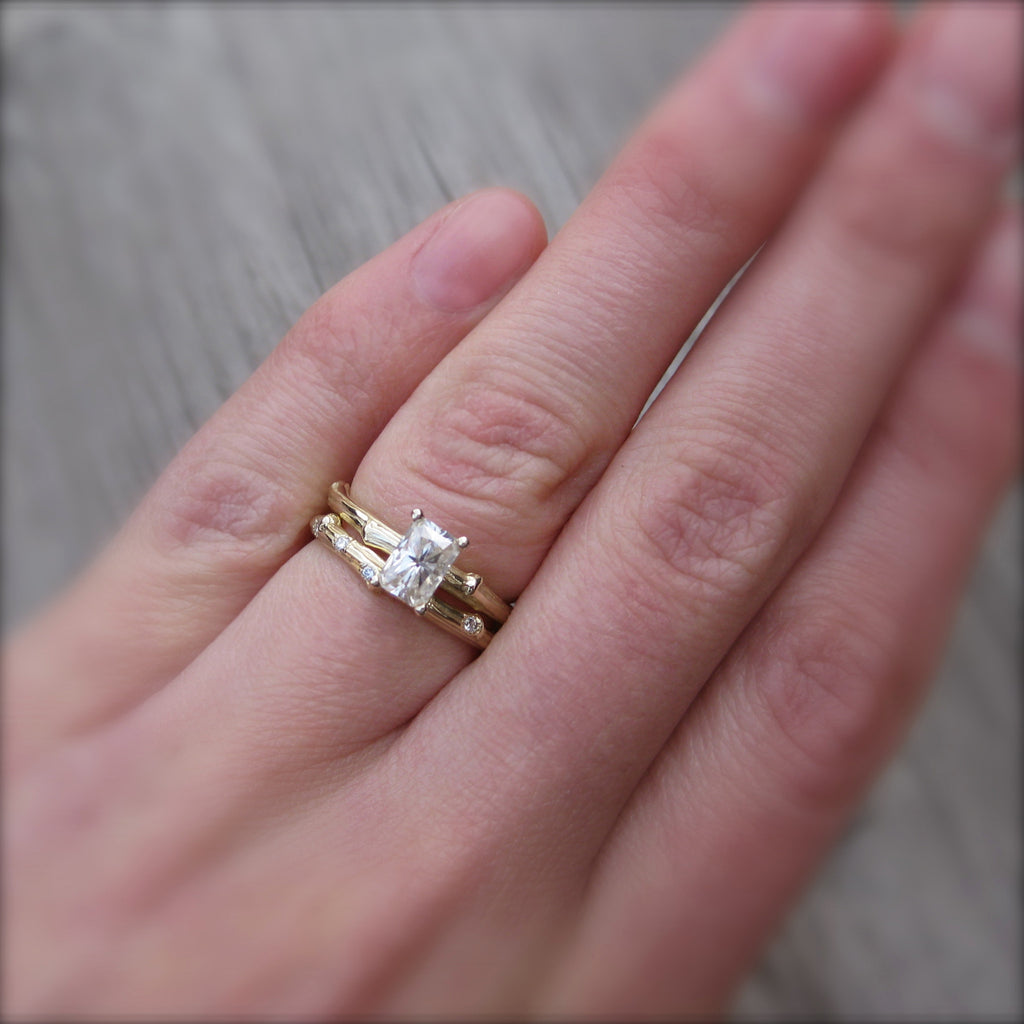 Stackable twig engagement ring with a radiant cut moissanite with branch wedding band
