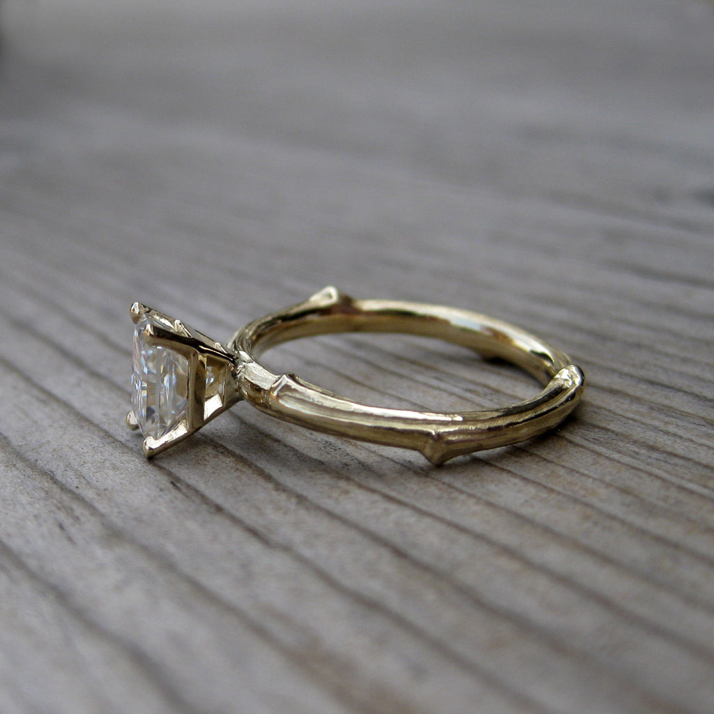 Ethical branch engagement ring with a radiant cut moissanite