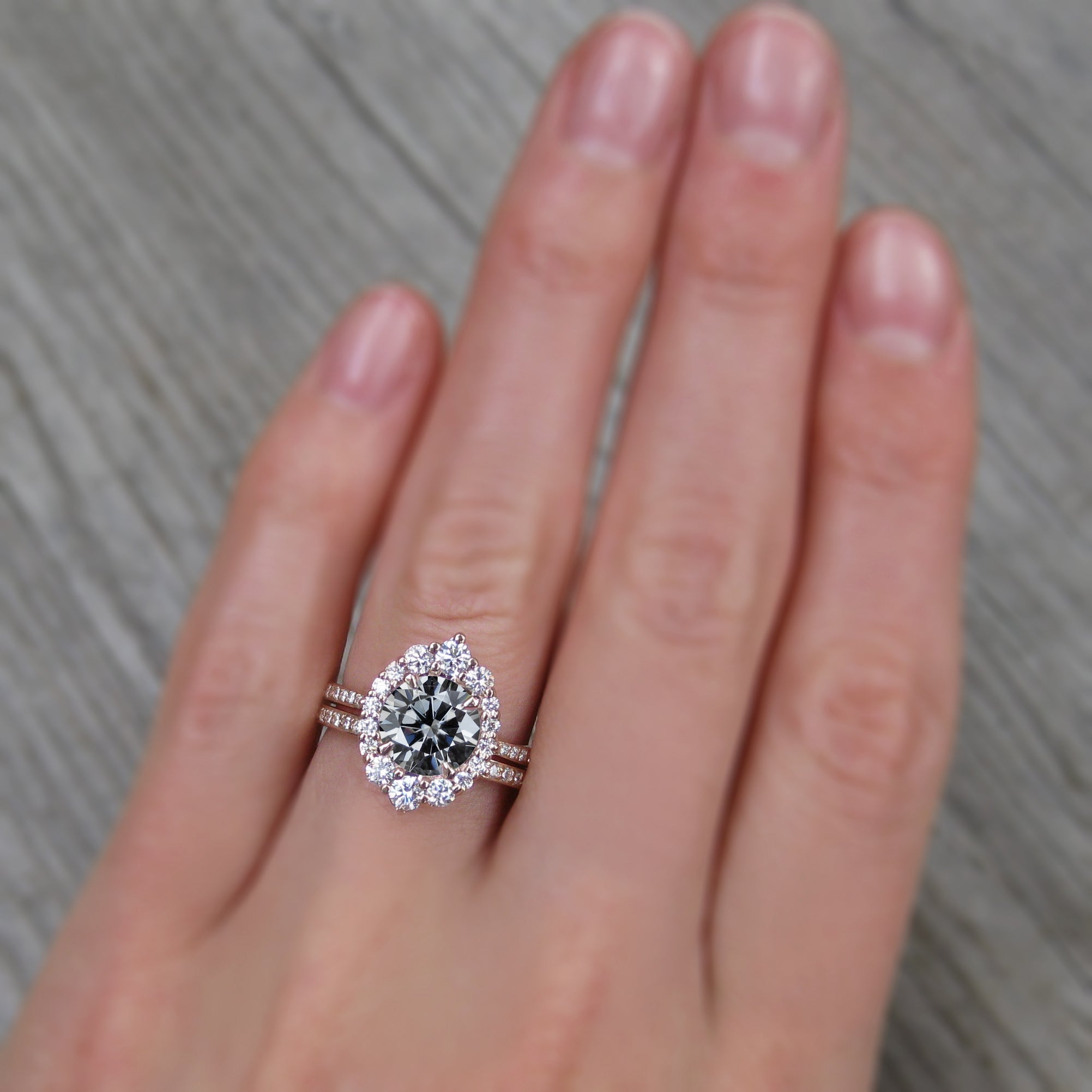 grey iconic moissanite engagement ring with diamond halo pavé