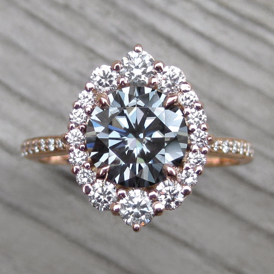 2ct vintage inspired rose gold halo with a grey moissanite center and conflict-free diamond band
