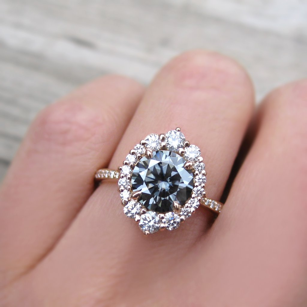 grey moissanite art deco halo ring in rose gold with a diamond halo and diamond band