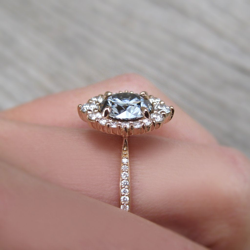 low-profile halo ring with a gray moissanite and diamonds in rose gold