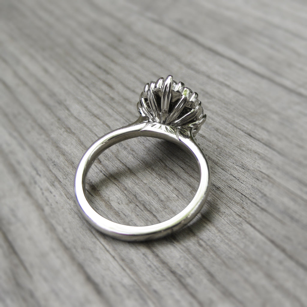 Vintage-inspired recycled white gold halo engagement ring