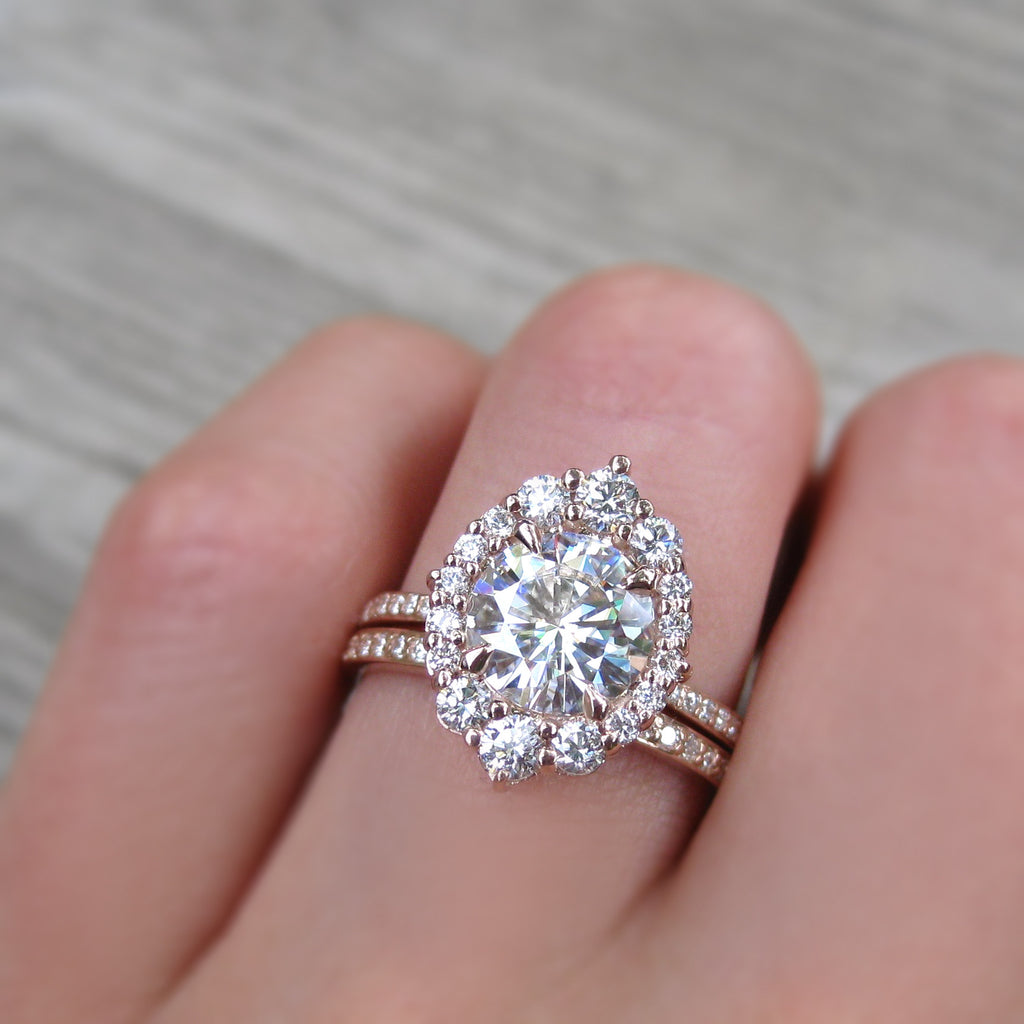 2 carat halo engagement ring paired with a conflict-free pavé wedding band