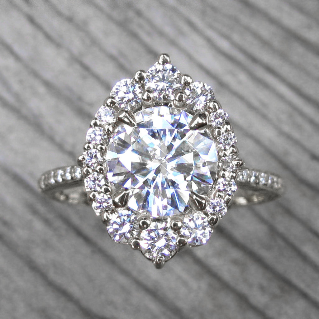 Vintage inspired Hearts & Arrows moissanite halo ring + conflict-free diamonds in white gold