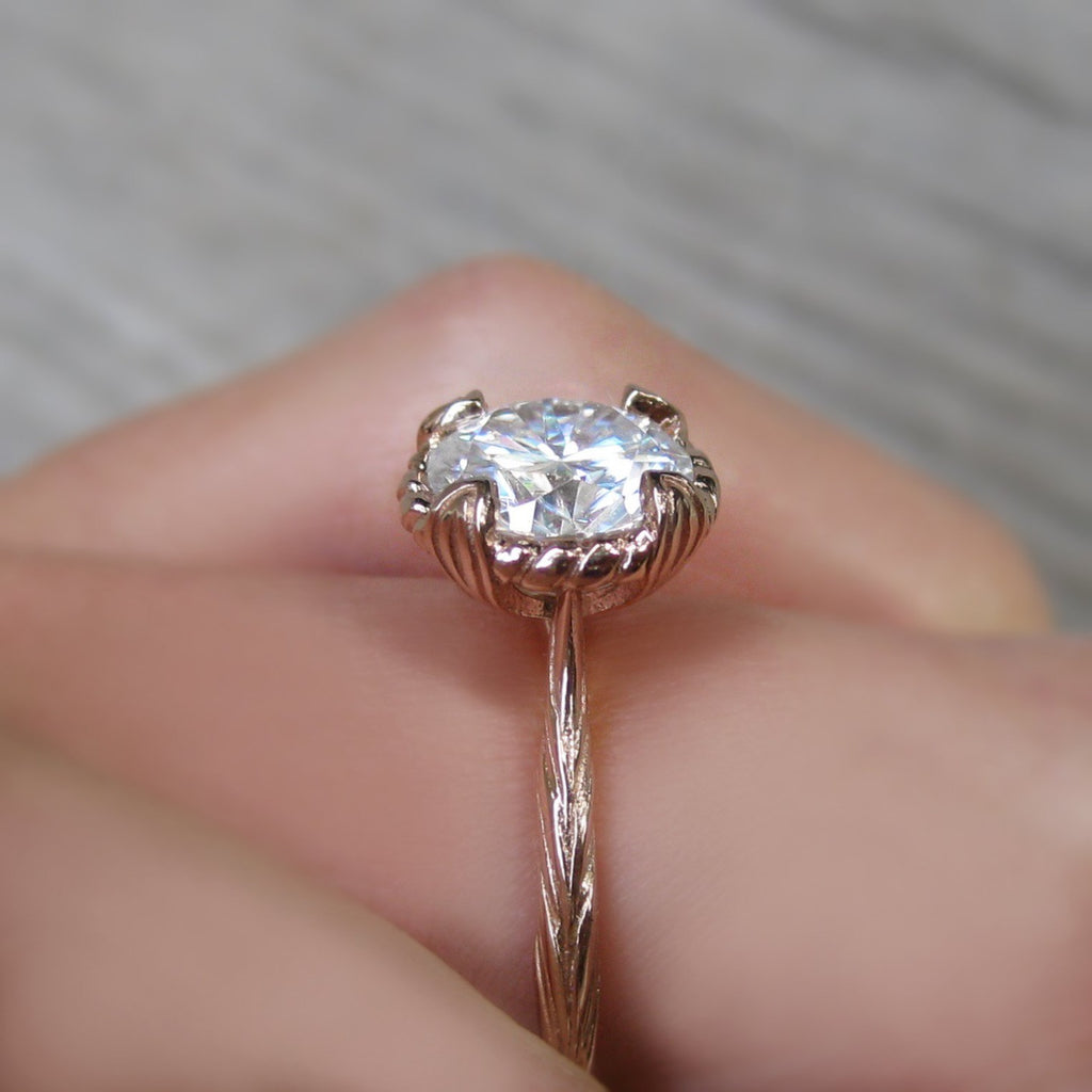 Profile view of 1.5ct Forever One Moissanite Rose gold solitaire engagement ring