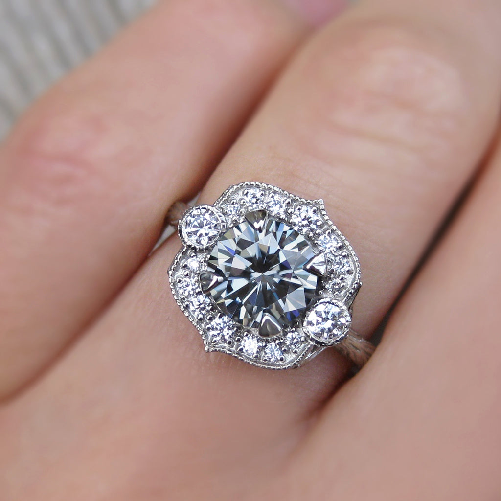 Vintage art deco style halo ring with grey moissanite and a twig band