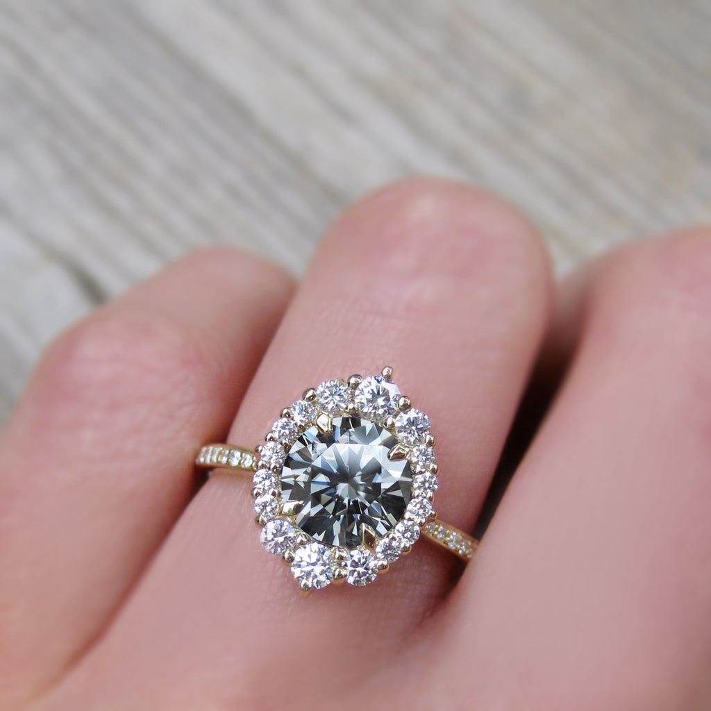 Vintage art deco style halo ring with grey moissanite and a diamond band
