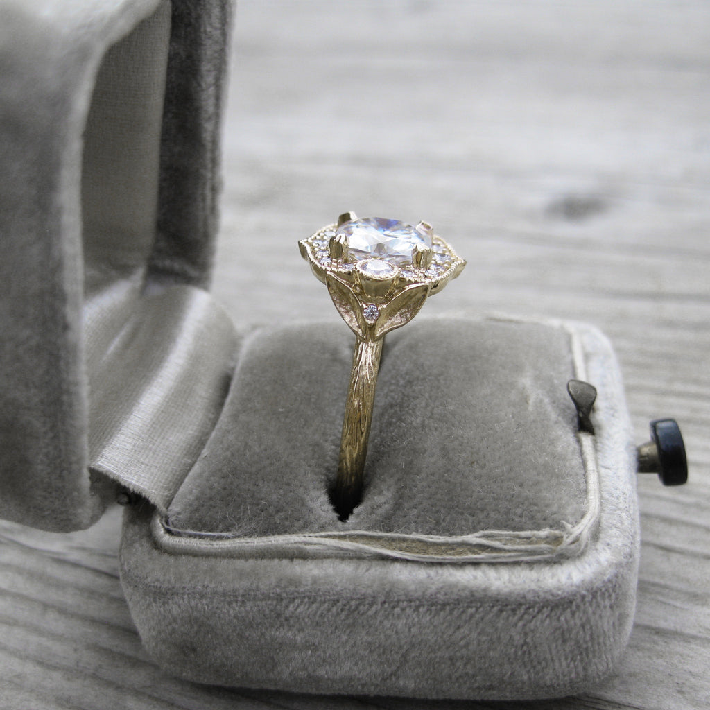 Low profile cushion cut moissanite vintage halo ring in yellow gold