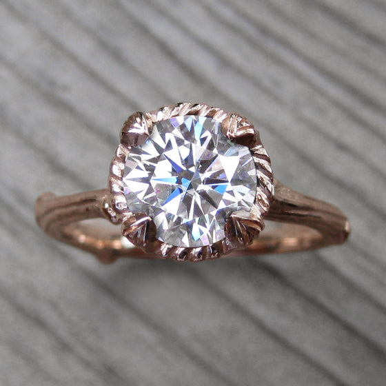 1.25ct rose gold twig solitaire engagement ring with a Forever One Hearts & Arrows moissanite