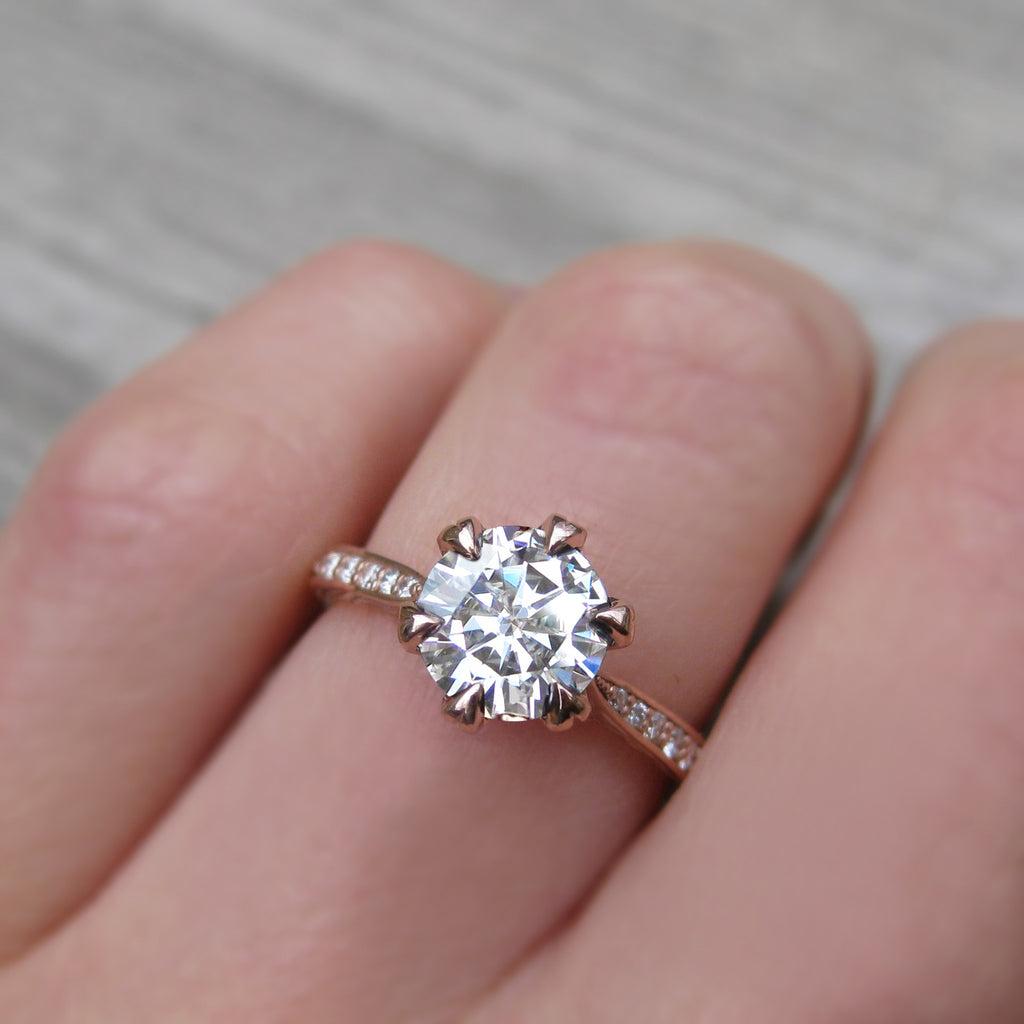 1.25ct solitaire engagement ring with a conflict-free pavé diamond band