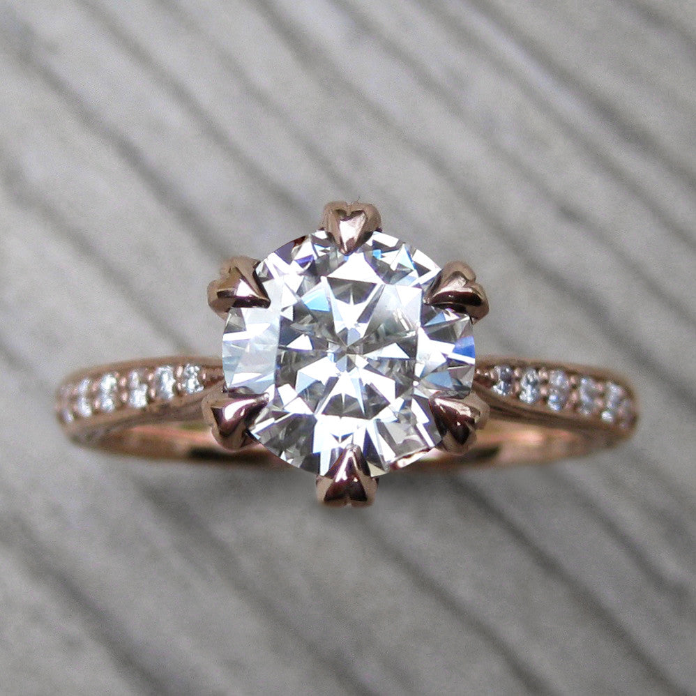 Top view of vintage inspired engagement ring with a lab grown diamond in 14k rose gold