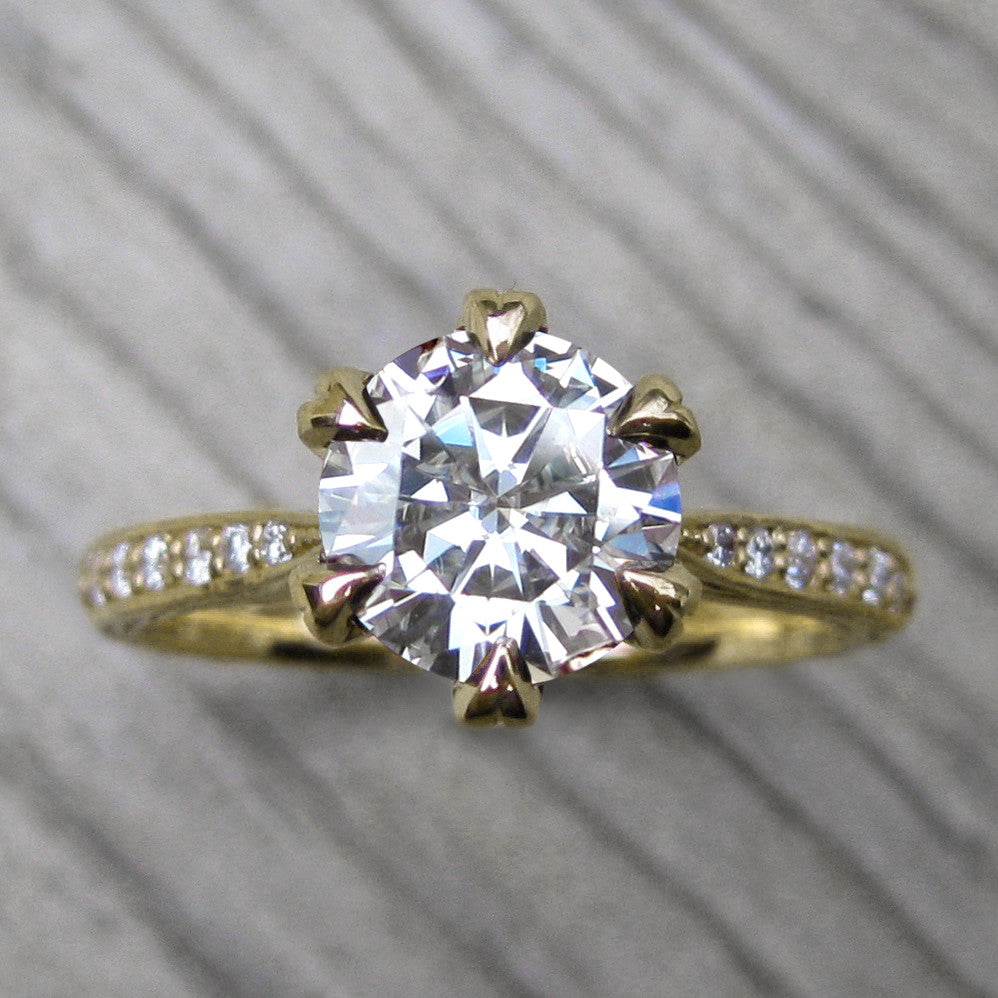 Top view of branch inspired engagement ring with a lab grown diamond in 14k yellow gold