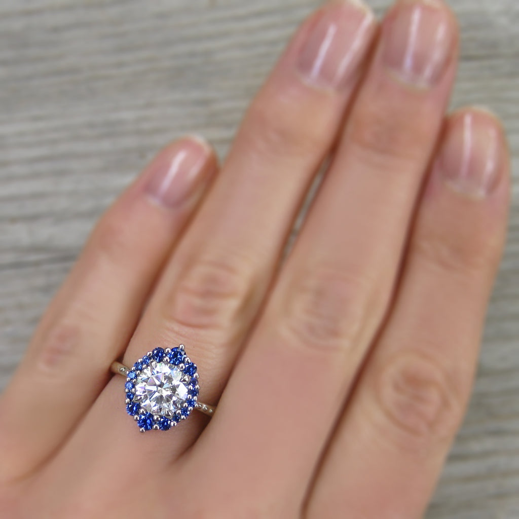 Antique-Inspired Halo Engagement Ring with a Forever One Moissanite Center with a Blue Sapphire Halo