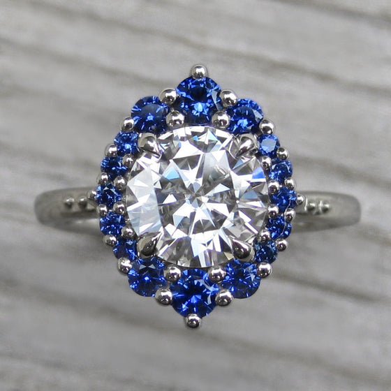 <center><strong>・EMERSON・</strong><br></center>Moissanite, Blue Sapphire Halo (1.67ct)