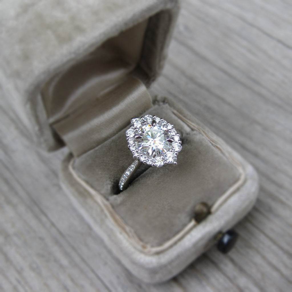 Vintage halo engagement ring with ethical diamonds in 14k gold modeled in vintage ring box