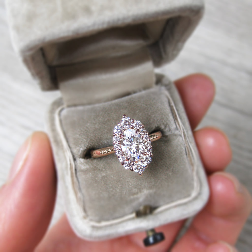 vintage-inspired and low-profile oval lab-created diamond halo engagement ring with a Canadian diamond halo in rose gold
