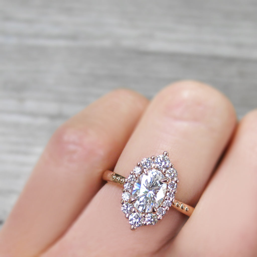 antique-inspired and low-profile oval lab-created diamond halo engagement ring with a Canadian diamond halo in rose gold