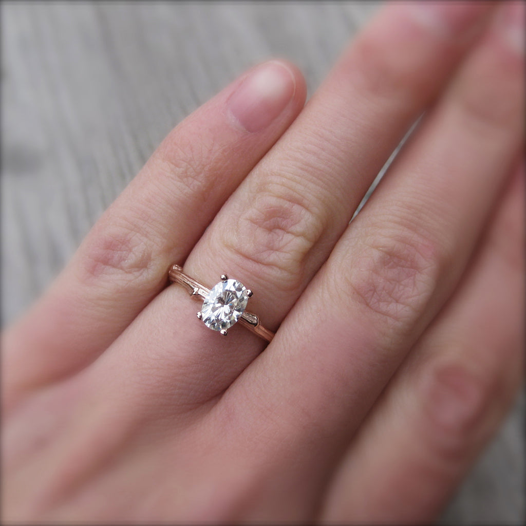 1ct rose gold twig solitaire engagement ring with a Forever One oval cut moissanite