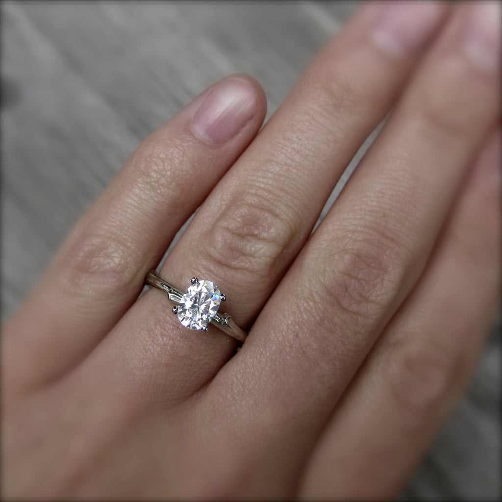 1ct white gold twig solitaire engagement ring with a Forever One oval cut moissanite
