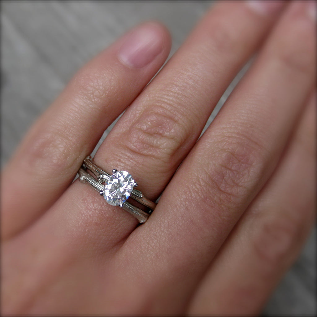 Ethical branch stackable engagement ring with oval cut moissanite