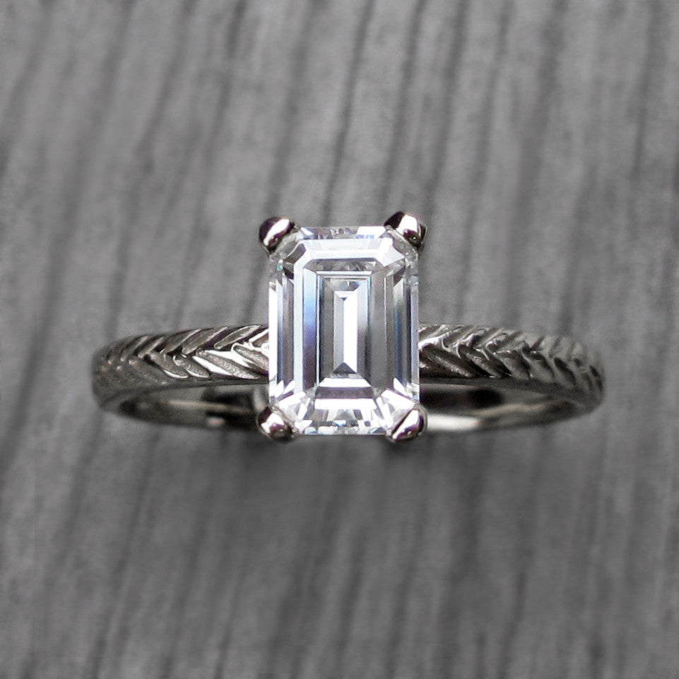 Ethical feather stackable engagement ring with a emerald cut moissanite