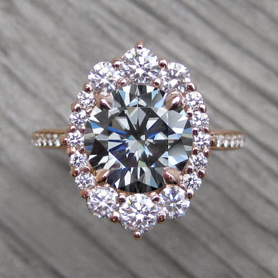 3ct rose gold grey moissanite halo ring with a diamond band and diamond halo