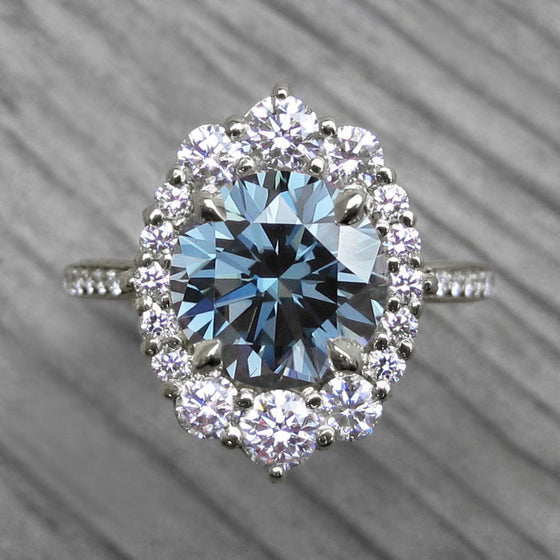 Vintage-Inspired Blue-Grey Moissanite Center Stone with a Diamond Halo and Band in White Gold
