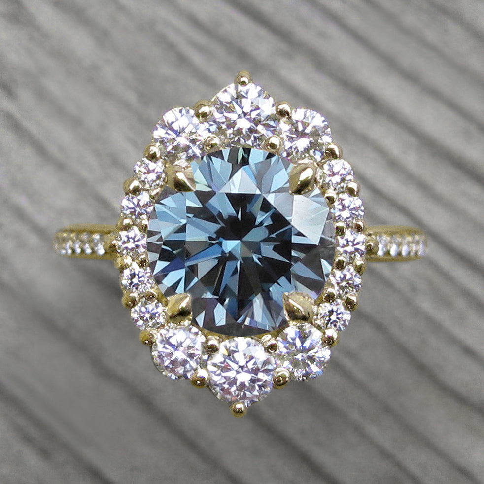 Vintage-Inspired Blue-Grey Moissanite Center Stone with a Diamond Halo and Band in Yellow Gold