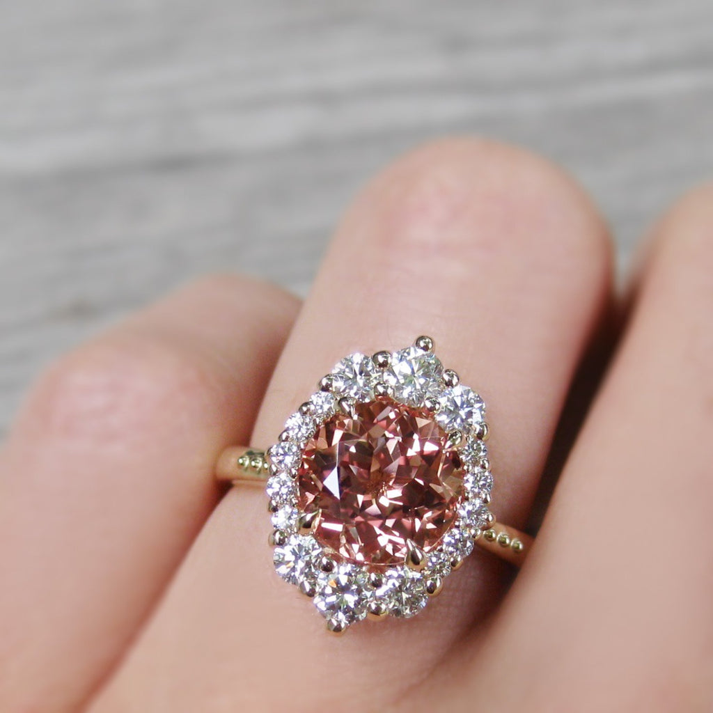 Lab-Grown Peach Sapphire Halo Engagement Ring with Diamonds in yellow gold