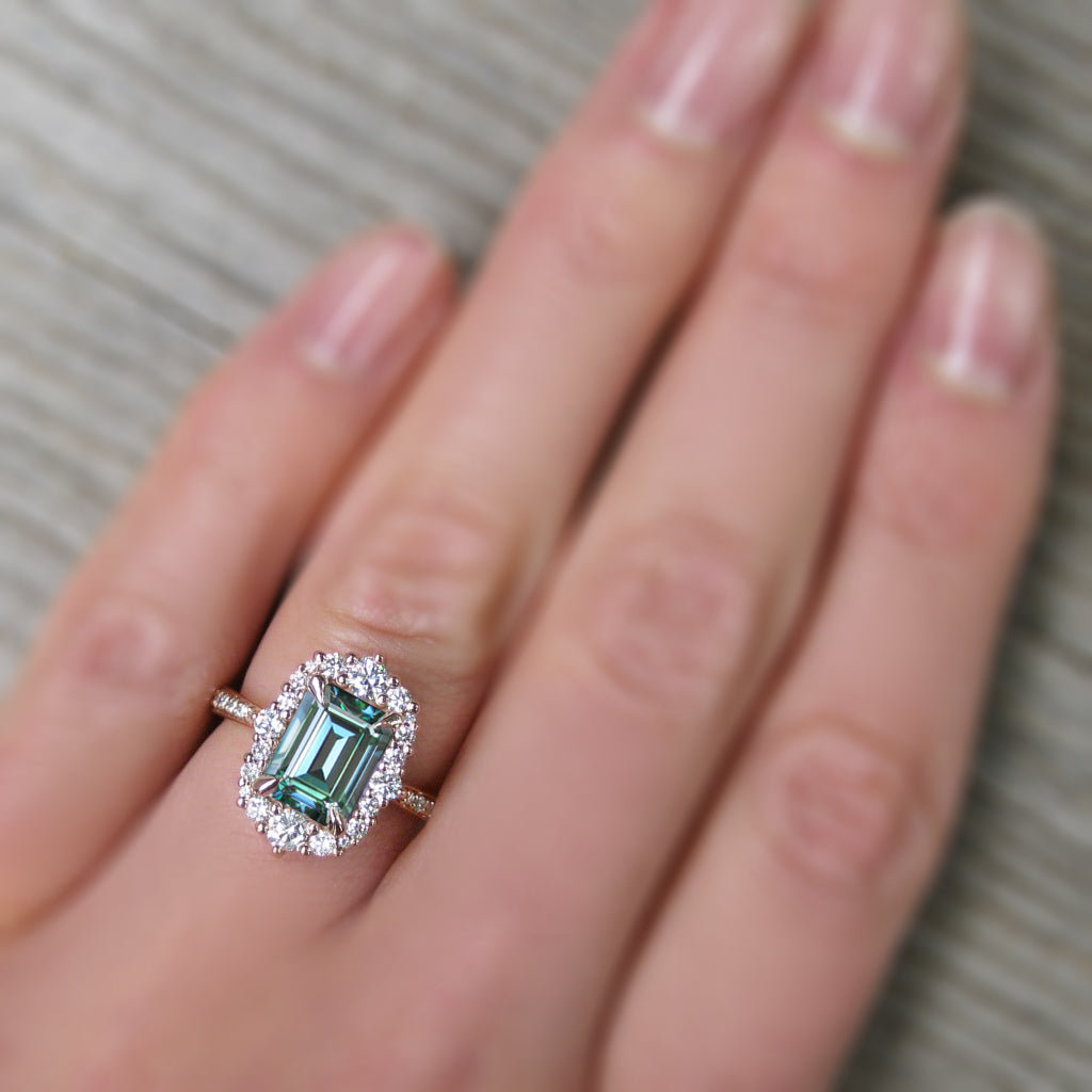 Art Deco inspired emerald cut aquamarine halo ring