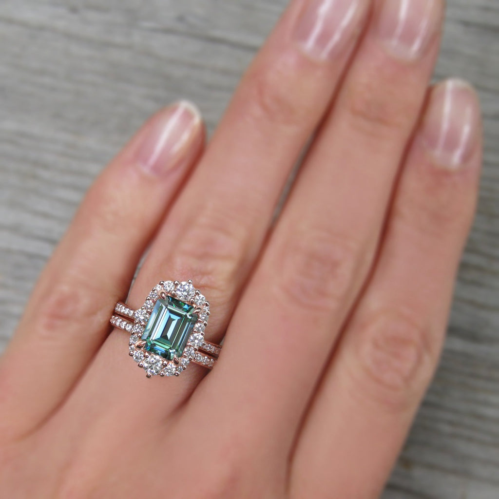 <center><strong>・ADELINE・</strong><br></center>Aqua-Teal Iconic™ Emerald Cut Moissanite Center, Diamond Halo (2.16ctw+)