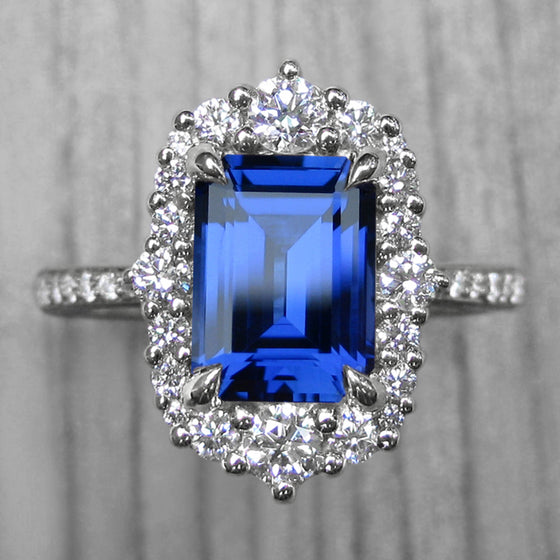 <center><strong>・ADELINE・</strong><br></center>Emerald Cut Blue Sapphire, Diamond Halo & Band (2.67ct+)