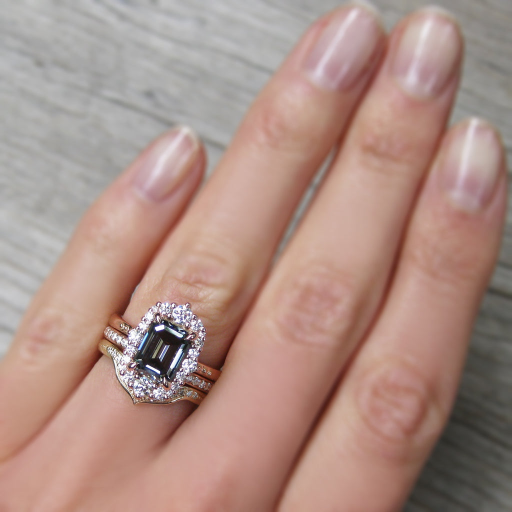 Emerald cut Iconic Grey Moissanite Diamond Halo Ring in rose gold stacked with two wedding bands