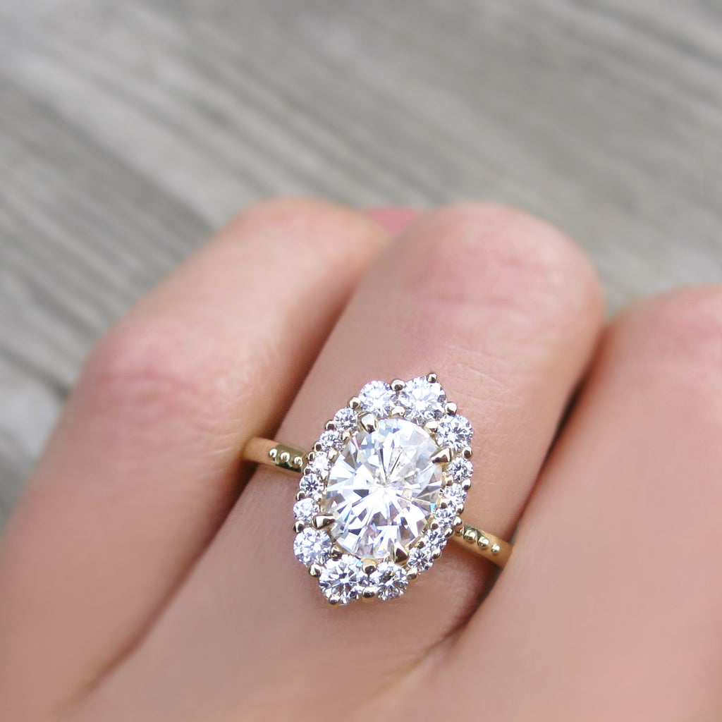 low-profile and stackable vintage oval lab grown diamond halo engagement ring in yellow gold