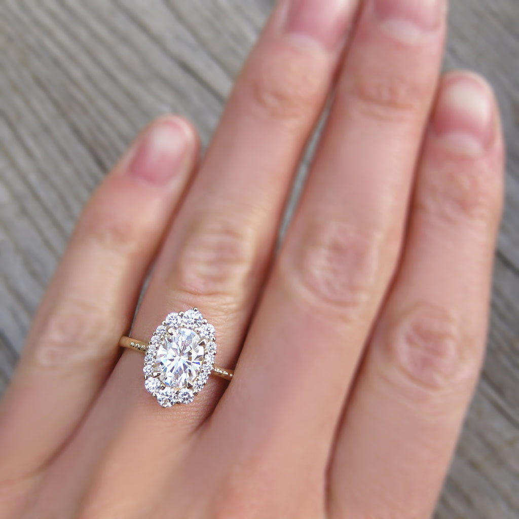 low profile antique-inspired oval lab grown diamond halo engagement ring