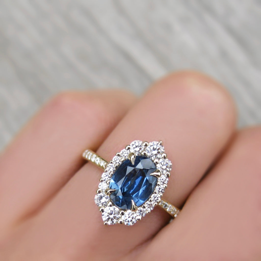 <center><strong>・SOFIA・</strong><br></center>Oval Montana Sapphire Center, Diamond Halo (1.58ctw+)