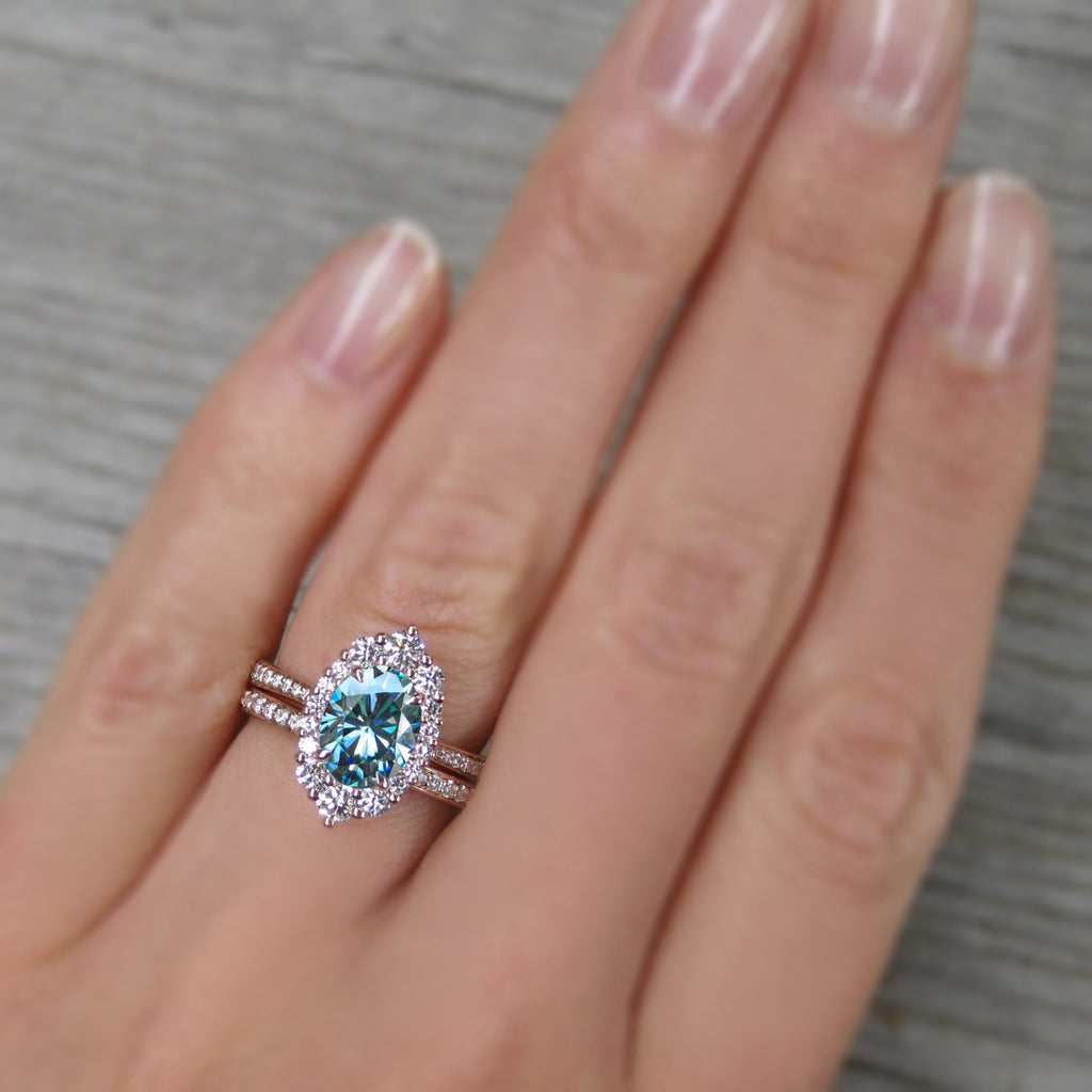oval aquamarine halo engagement ring