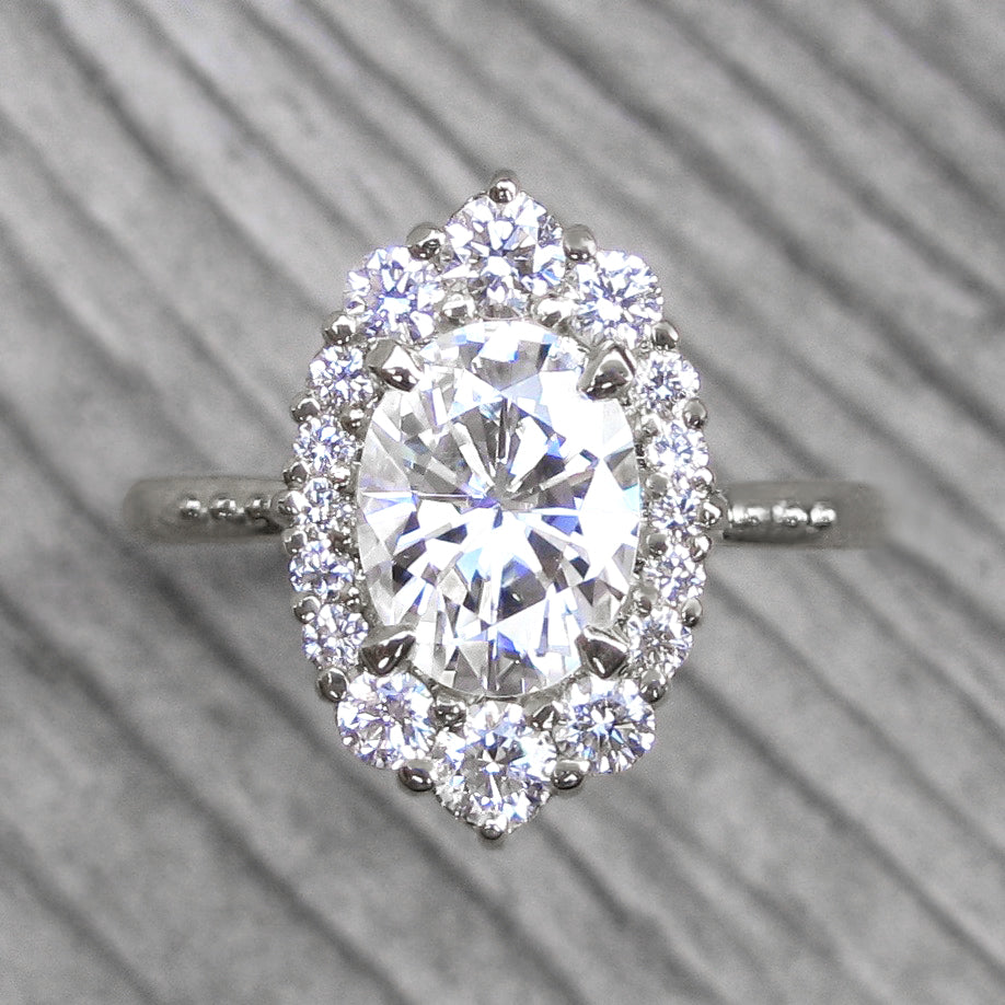 Vintage-inspired 1.5ct lab-grown oval diamond halo engagement ring in white gold