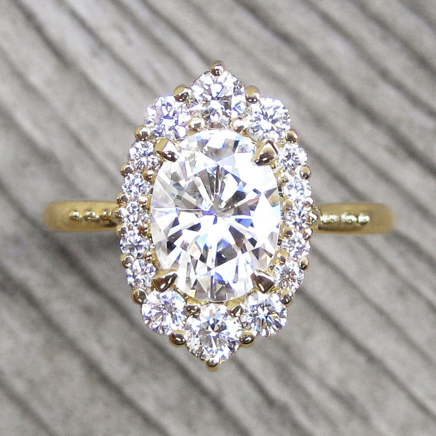 Vintage-inspired 1.5ct lab-grown oval diamond halo engagement ring in yellow gold