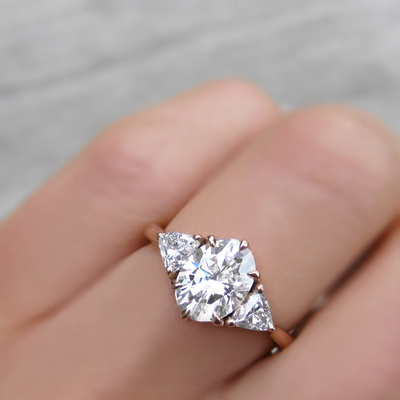 unique 3-stone oval moissanite and lab-grown diamond engagement ring