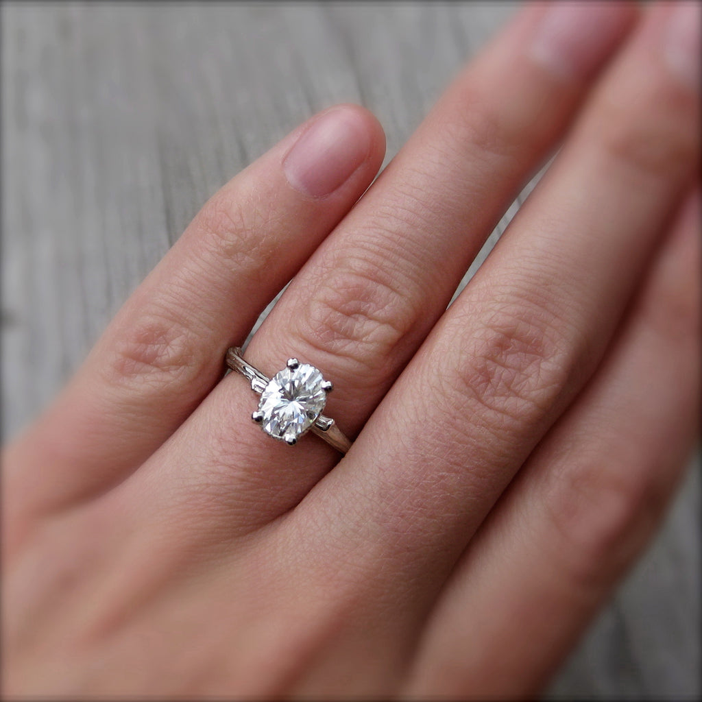 Eco Friendly twig ring with a Forever One oval cut moissanite