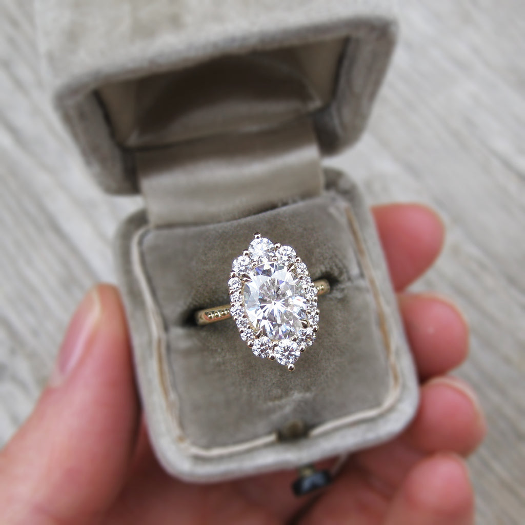 antique-inspired oval lab grown diamond halo engagement ring