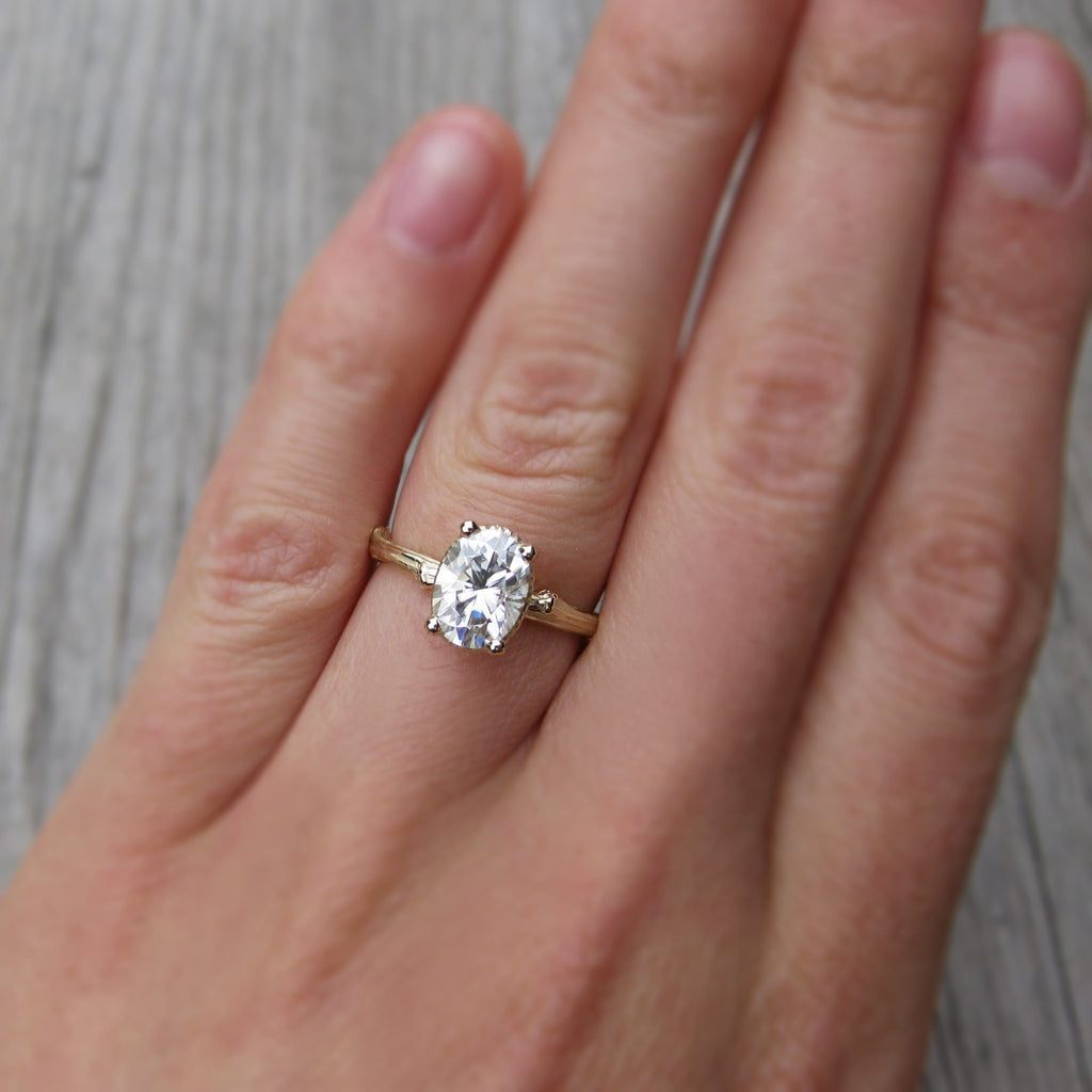 Forever One oval moissanite nature inspired ring in rose gold, white gold, or yellow gold