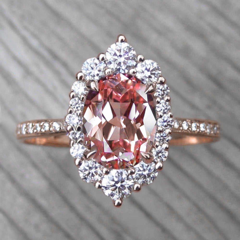 Oval Peach sapphire engagement ring with a conflict-free diamonds halo in rose gold