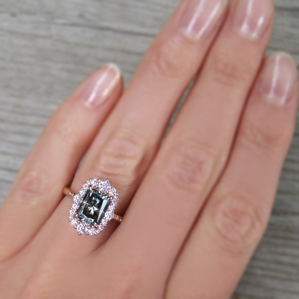 Vintage-Inspired radiant cut Iconic Grey Moissanite Diamond Halo Ring in rose gold on a size 5 finger