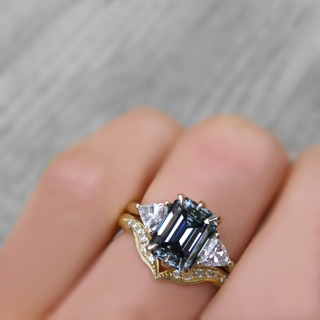 <center><strong>・AVERY・</strong><br></center>Emerald Cut Iconic™ Grey Moissanite Center, Trillion Diamonds (2.17ctw)